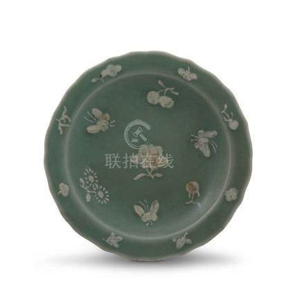 A Chinese celadon moulded dish, Qing Dynasty, 19th century