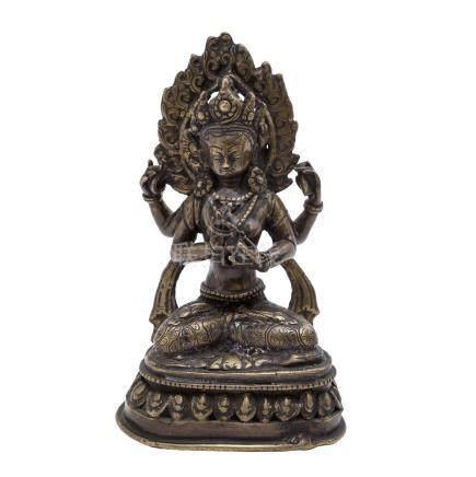 Figur einer vierarmigen Göttin. TIBET, 20. Jh..Auf einem Thron im Meditationssitz dargestellt, H