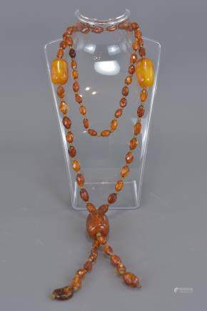 A 1920's amber beaded necklace. 58g