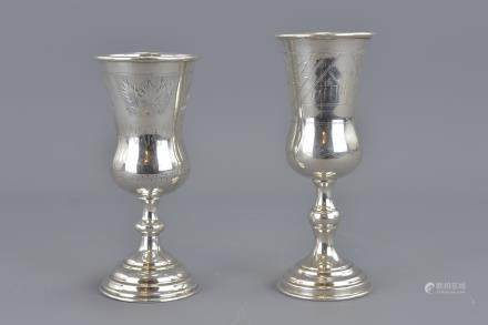 Two Kiddush silver cups one with mark stamped 84. 14cm and 15cm tall