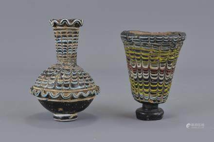 Two Islamic glass vessels 8.5cm height and 10cm height