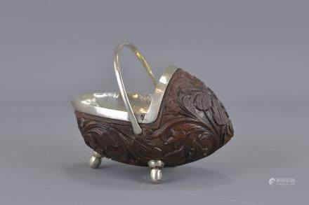 A Colonial silver and carved nut basket. 11cm length x 8cm height