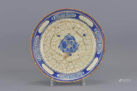 A central Asian pottery dish 18th/19th century. 24cm diameter