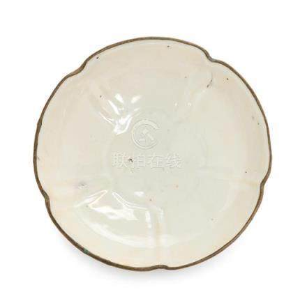 A Ding- Type White Glazed Porcelain Floriform Plate