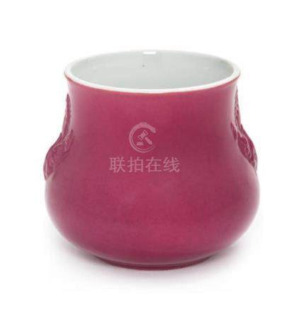 * A Pink Glazed Porcelain Jar Height 3 1/2 inches.
