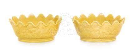A Pair of Yellow Glazed Porcelain Floriform Vessels