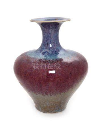 * A Flambe Glazed Stoneware Vase Height 10 1/2 inches.