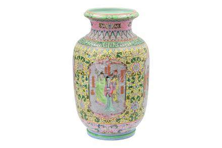 A polychrome porcelain vase, decorated with figures in cartouches and flowers