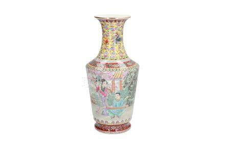 A polychrome porcelain vase, decorated with figures in a garden, a phoenix and a poem