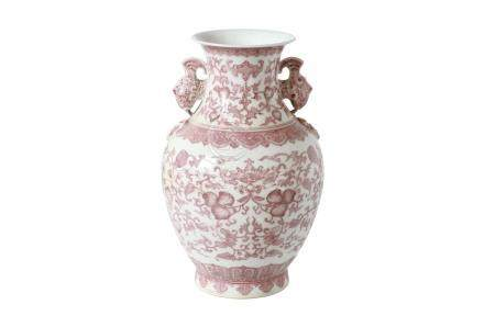 An underglaze red and white porcelain vase, decorated with flowers