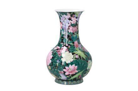 A polychrome porcelain vase, decorated with flowers