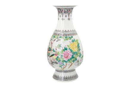 A polychrome porcelain vase, decorated with birds, flowers and characters