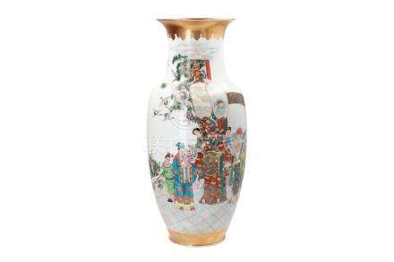 A polychrome porcelain vase, decorated with figures, a dignitary, birds, flowers and a poem