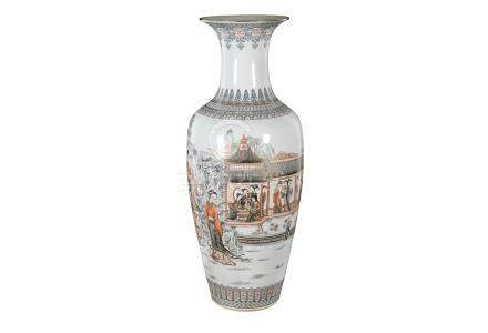 A polychrome porcelain vase, decorated with figures on a terrace