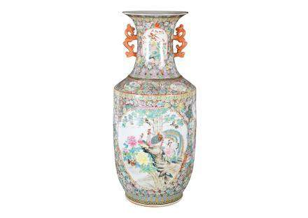 A polychrome porcelain vase with two handles, decorated with birds and flowers