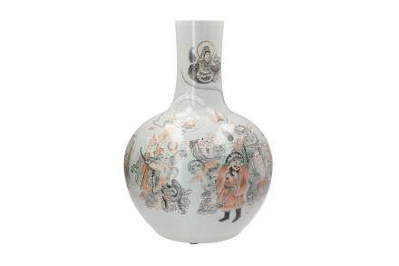 A polychrome porcelain vase, decorated with figures and a dragon