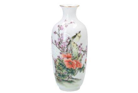 A polychrome porcelain vase, decorated with a bird and flowers