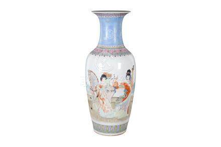 A large polychrome porcelain vase, decorated with a lady playing the lute and a lady with a horse