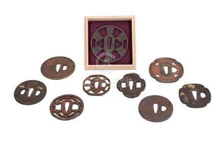 Lot of nine iron tsuba's, with decorations including rat, shishi, flowers and skull