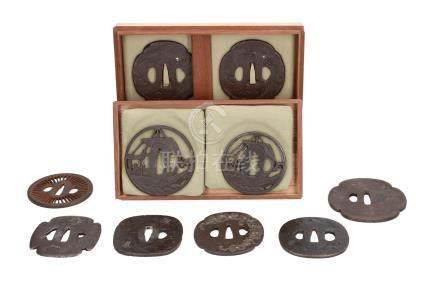 Lot of ten iron tsuba's, with decorations including flowers and ships