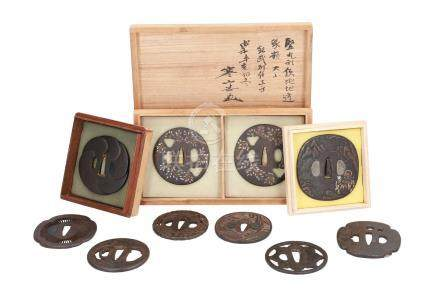 Lot of ten iron tsuba's, with decorations including flowers and figures