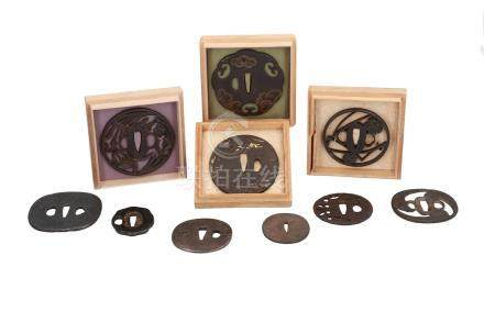 Lot of ten iron tsuba's, with decorations including flowers and houses