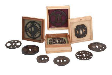 Lot of ten iron tsuba's, with decorations including lotus flower, dragon fly and characters