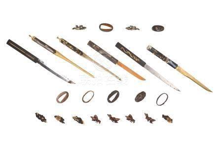 Lot of 23 sword parts, including menuki, mekugi, fuci and kozuka