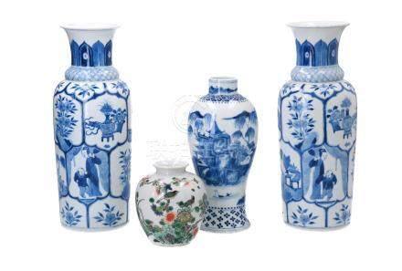 A pair of blue and white porcelain vases, decorated with long Elizas and little boys