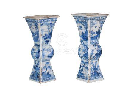 A pair of blue and white porcelain trumpet vases, decorated with figures in landscapes