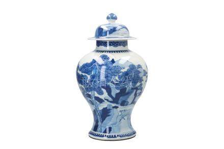 A blue and white porcelain lidded vase, decorated with animals in mountainous river landscape