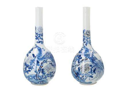 A pair of blue and white porcelain longneck vases, decorated with phoenix and peonies