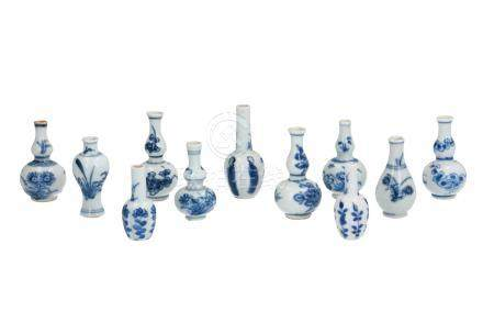 Lot of eleven blue and white porcelain miniature vases, decorated with flowers, long Elizas, butterfly, duck and bird