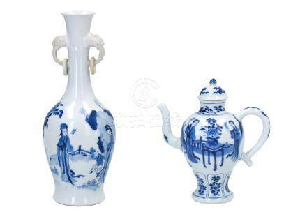 A blue and white porcelain vase with handles in the shape of elephant heads, decorated with long Elizas and little boy