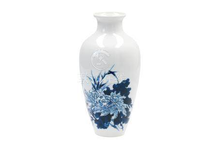 A blue and white porcelain vase, decorated with flowers in the style of Wang Bu