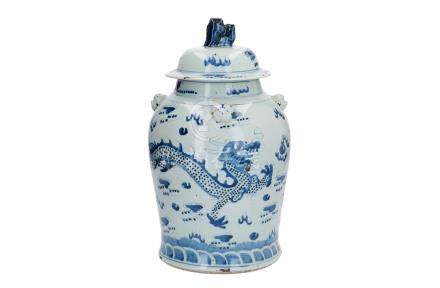 A blue and white porcelain lidded jar, decorated with dragons chasing the burning pearl