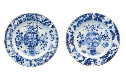 A pair of blue and white porcelain dishes, decorated with flowers and figures