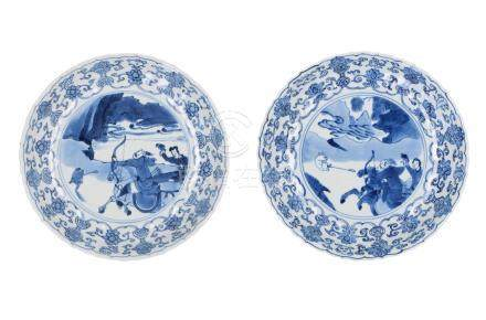 A pair of blue and white porcelain dishes, decorated with a hunting scene