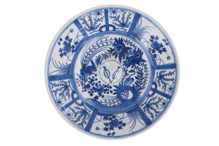 A blue and white porcelain dish, decorated with flowers, birds and VOC