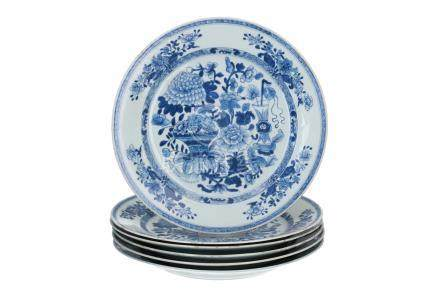 A set of six blue and white porcelain dishes, decorated with flowers and vases