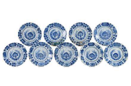 A set of nine blue and white porcelain dishes with floral decor