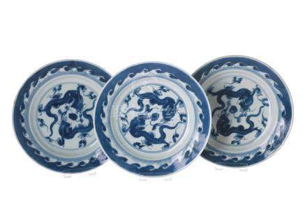 Set of three dishes, decorated with dragons chasing the burning pearl