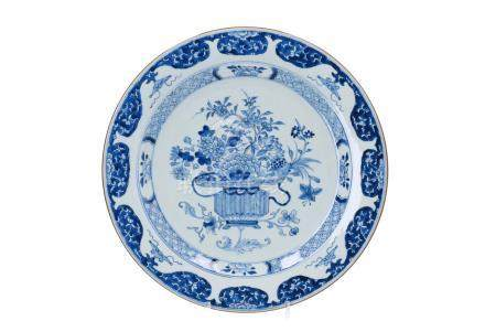 A blue and white porcelain charger, decorated with flowers and ruyi