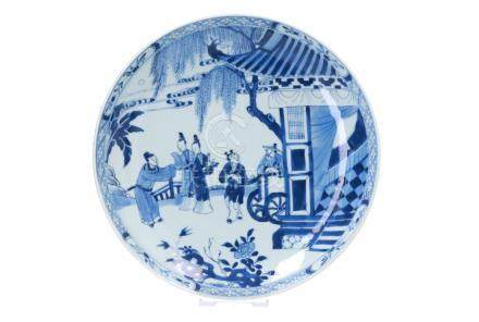 A blue and white porcelain deep dish, decorated with a scene from the Western Chamber depicting figures in a garden with a man in carriage