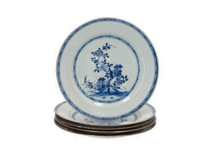 A set of five blue and white porcelain dishes, decorated with flowers