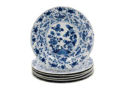 A set of six blue and white porcelain dishes, decorated with fruits