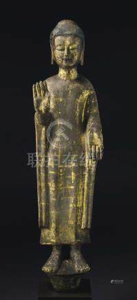 A VERY RARE AND IMPORTANT GILDED GREY STONE FIGURE OF BUDDHA