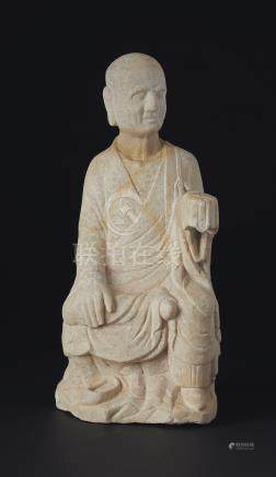 A WHITE MARBLE FIGURE OF A SEATED LUOHAN