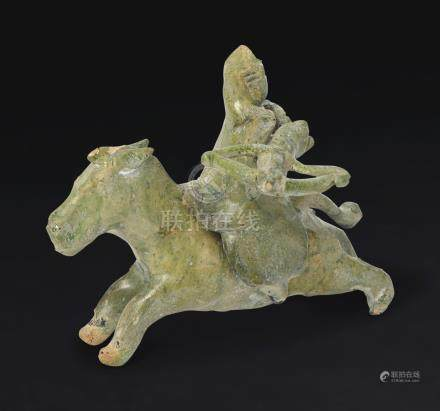 A RARE MINIATURE GREEN-GLAZED POTTERY FIGURE OF AN EQUESTRIAN ARCHER