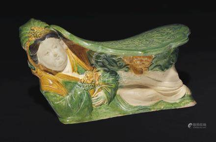 A RARE CREAM, AMBER AND GREEN-GLAZED FIGURAL PILLOW